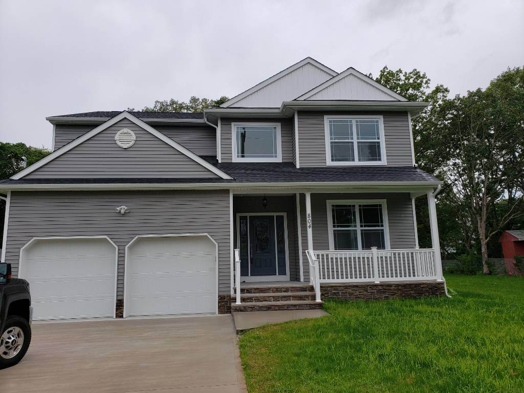 Grey and white house with porch and garage